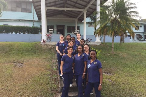 Nursing students and faculty stand outside of La Loma Luz Adventist Hospital. Photo by: Students